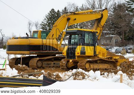 Tractor And Excavator At A Construction Site Yellow Road