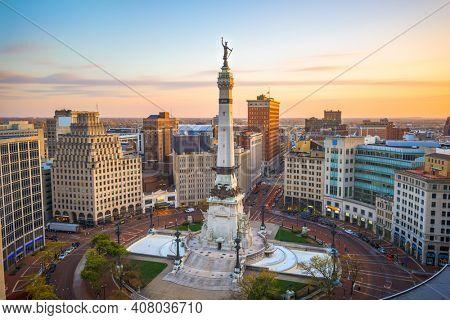 Indianapolis, Indiana, USA skyline over Monument Circle at dusk.
