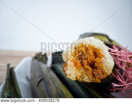 Close-up Of The Pulut Panggang Or Grilled Glutinous Rice Wrapped In Banana Leaves With Spicy Desicca