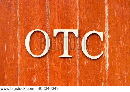 Alphabet Letter In Word Otc (abbreviation Of Over The Counter) On Old Red Color Wood Plate Backgroun
