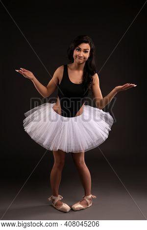 Funny Ballerina In Tutu Skirt In Studio