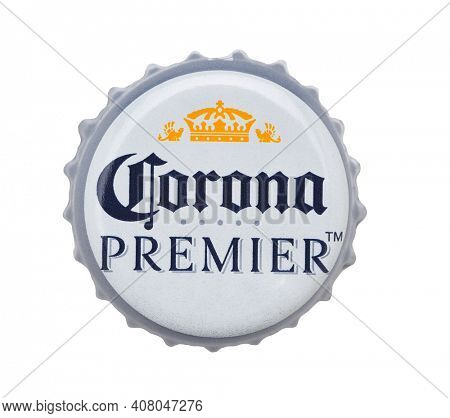 IRVINE, CALIFORNIA - 4 JUNE 2020: Closeup of a Corona Premier beer bottle cap on white.