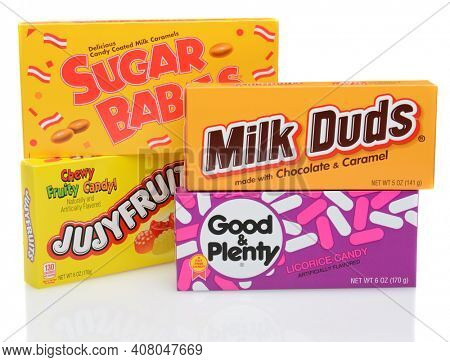 IRVINE, CA - DECEMBER 12, 2014: Four boxes of candy. Sugar Babies, Jujyfruits, Good and Plenty and Milk Duds are favorite snacks for movie goers at American theaters.
