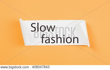 Slow Fashion Text On Tirn Notice Paper On Plain Yellow Background. Sustainable Approach To Manufactu