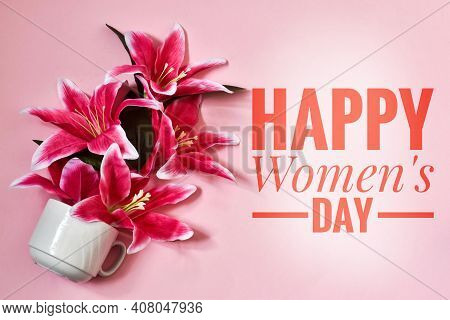 Greeting Card International Women's Day On March 8th. White Cup With Lily Flowers On A Pink Backgrou