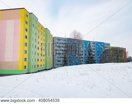 Typical Prefabricated Construction In  White Snow.  Colorful Apartment Residential Buildings In Cont