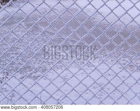 Metal Mesh In White Frosty Frost In Winter. Fence Mesh. White Snow. Frosty Frost. Winter Season. Mes