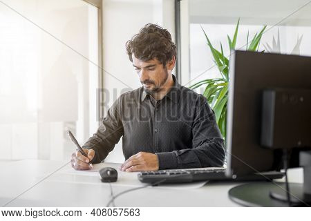 Man Behind The Desk, Customer Support Service At The Office From Bank Or Insurance Company.