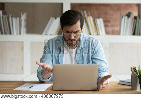 Unhappy Male Employee Confused By Mistake On Laptop
