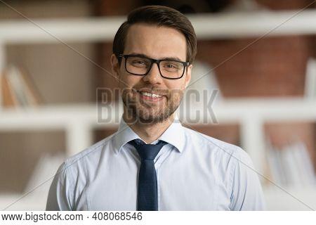 Headshot Portrait Of Smiling Caucasian Businessman In Glasses