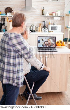 Happy Remote Daughter And Niece Talking With Granparents Using Webcam, Online Connection, Senior Per