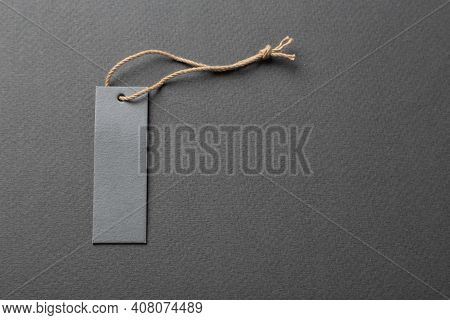 Clothing Tag, Label Blank Mockup Template On A Paper Background. Price Tag, Gift Tag, Sale Tag.