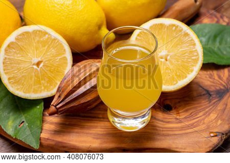 Ice Cold Sweet Limoncello Liqueur Made From New Harvest Of Fresh Ripe Yellow Italian Lemons, Amalfi