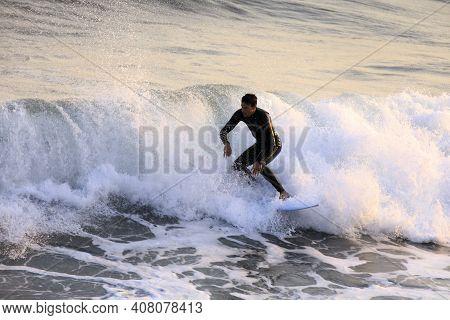 Alassio (sv), Italy - December 12, 2017: Surfer In Alassio Sea, Riviera Dei Fiori, Savona, Liguria,