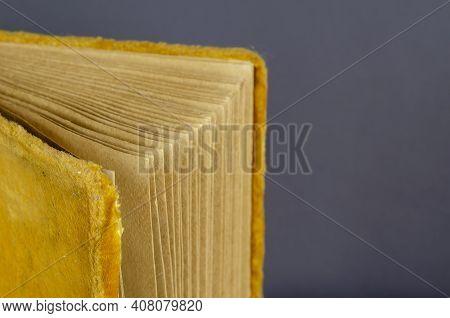 Opened Old Photo Album Wrapped In Yellow Velvet On Gray Background. Vintage Yellow Photo Album Verti