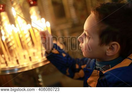 Child With Candle In Church Of Raifa Monastery