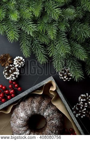 Fresh Baked Homemade Cake With Winter Spices With Decorations And Green Spruce Branches.christmas Ti