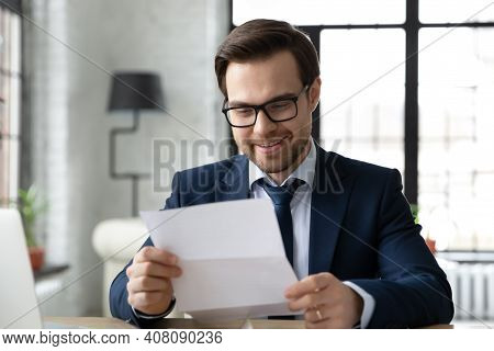 Happy Male Ceo Read Good News In Correspondence
