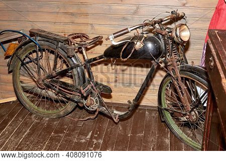 An Old Rusty Moped. The Old-fashioned Transport.
