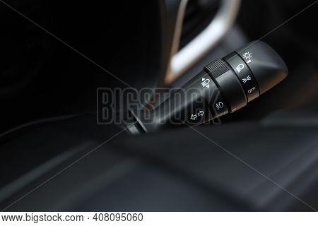 Close Up On Car Rain Windscreen Wiper Control Stick. Modern Car Interior