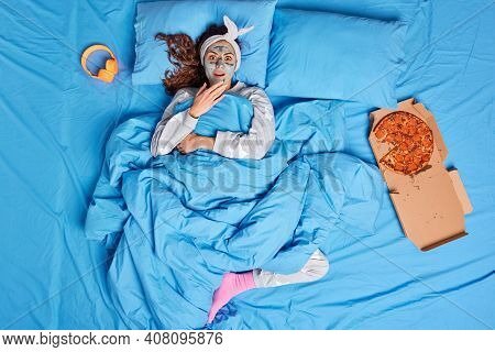 Photo Of Shocked Woman Applies Clay Mask On Face Doesnt Want To Get Up And Do Things Stays In Bed Re