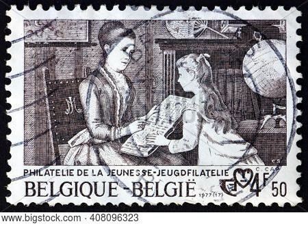Belgium - Circa 1977: A Stamp Printed In Belgium Shows Mother And Daughter With Album, By Constant C