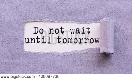 The Text Do Not Wait Until Tomorrow Appears On Torn Lilac Paper Against A White Background.