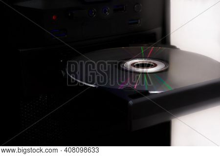 Cd Sitting In The Computer Cd- Rom Drive. Rainbow From Compact Disk.