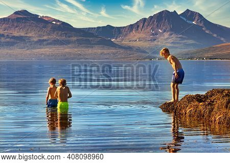 Tromso, Norway - August 18, 2016: Two Boys Take A Bath In The Cold Water Of Tromso, 350 Km North Of