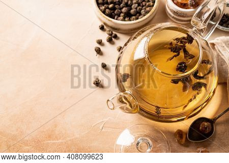 Organic Green Oolong Tea In A Glass Teapot On Light Background, Top View