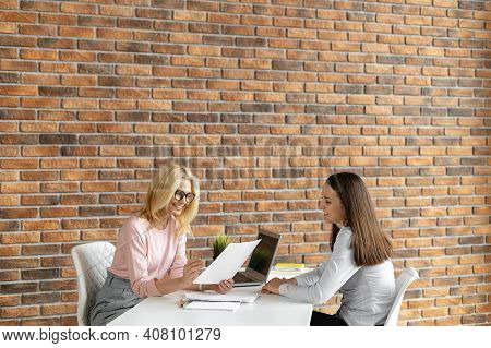 Confident Female Hr Manager Sitting At The Office, Considering, Signing An Agreement, Discussing Con
