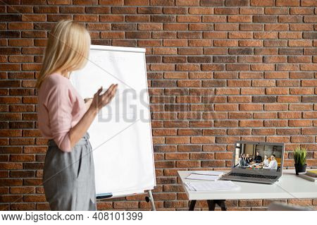 Successful Businesswoman Showing On Interactive Whiteboard Options For Increasing Sales, Presenting