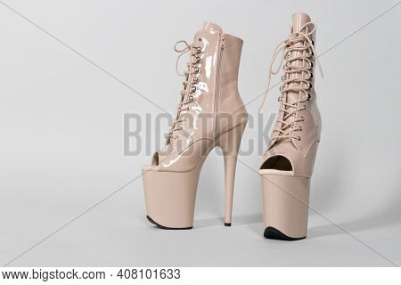 Beautiful Beige Shiny Shoes For Pole Dance Or Striptease On A Gray Background