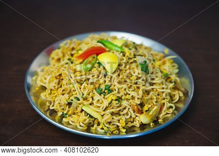 Nepali Waiwai Chowchow Noodles Cooked With Eggs And Vegetables Served On A Plate On The Table. Chau