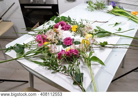 Backstage Of The Subject Shooting With Flowers. A Composition For Photographing Flowers Is Spread Ou