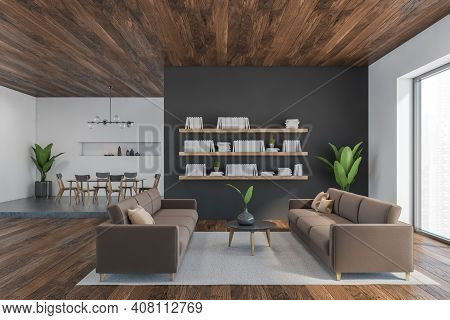 Brown And Wooden Living Room With Brown Sofa And Coffee Table With Plant, Shelf On The Wall With Boo