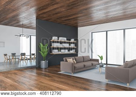 Brown And Wooden Living Room With Brown Sofa And Coffee Table With Plant, Side View, Shelf On The Wa