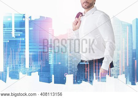 Businessman In White Shirt Holding His Jaket. Financial Charts As A Symbol Of Upcoming Meetings Abou