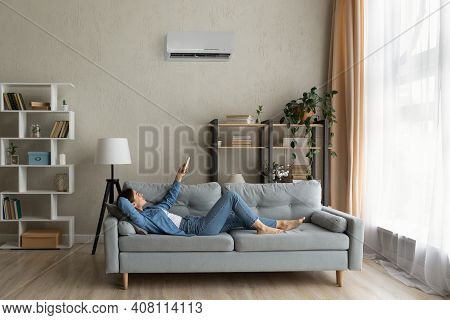 Happy Young Lady Regulate Climate At Home Using Ac Device
