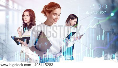 Three Young Women With Devices And Notes In Casual Clothes, Double Exposure Of Graphs And City Skysc