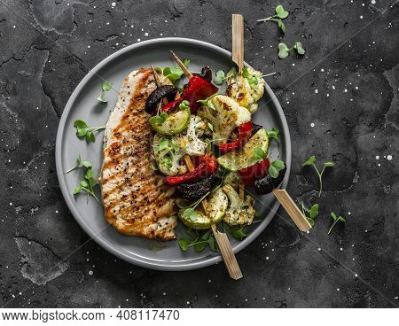 Grilled Pork Chops, Vegetables Skewers  On A Dark Background, Top View. Delicious Tapas