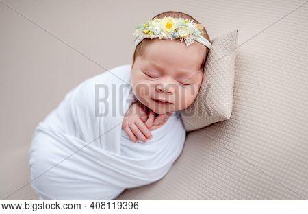 Smiling newborn in floral rim