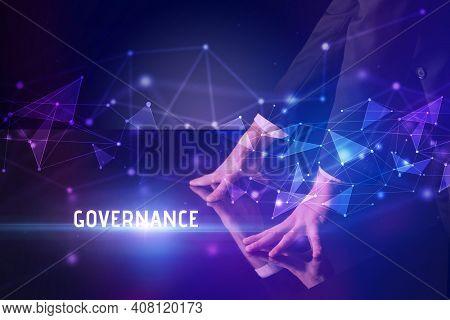 Businessman touching huge screen with GOVERNANCE inscription, modern technology business concept