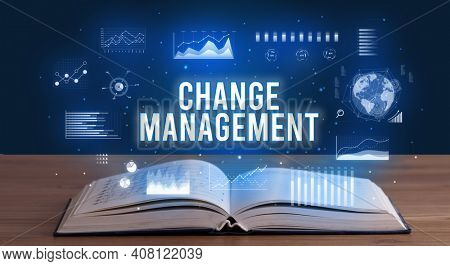 CHANGE MANAGEMENT inscription coming out from an open book, creative business concept