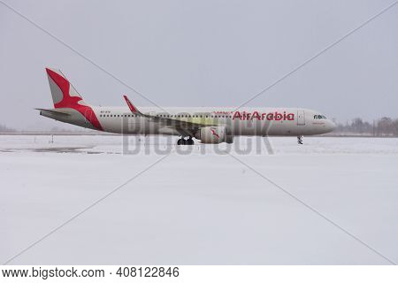 Ukraine, Kyiv - February 12, 2021: Poor Visibility, Fog. Passenger Plane A6-atd Air Arabia Airbus A3
