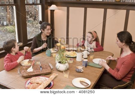 Family At Breakfast Table