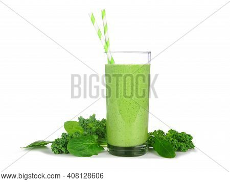 Green Smoothie With Kale And Spinach In A Glass. Side View With Ingredients Isolated On A White Back