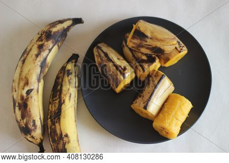 Ripe Plantain Steamed And Served On Dark Grey Medium Size Plate