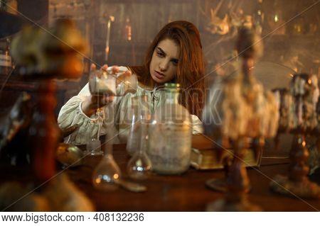 Demonic woman mixes potions, demons casting out