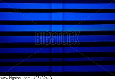 Window Shutters With Blue Led Lighting Texture Background. Creative Blue Neon Blinds. Bright Striped